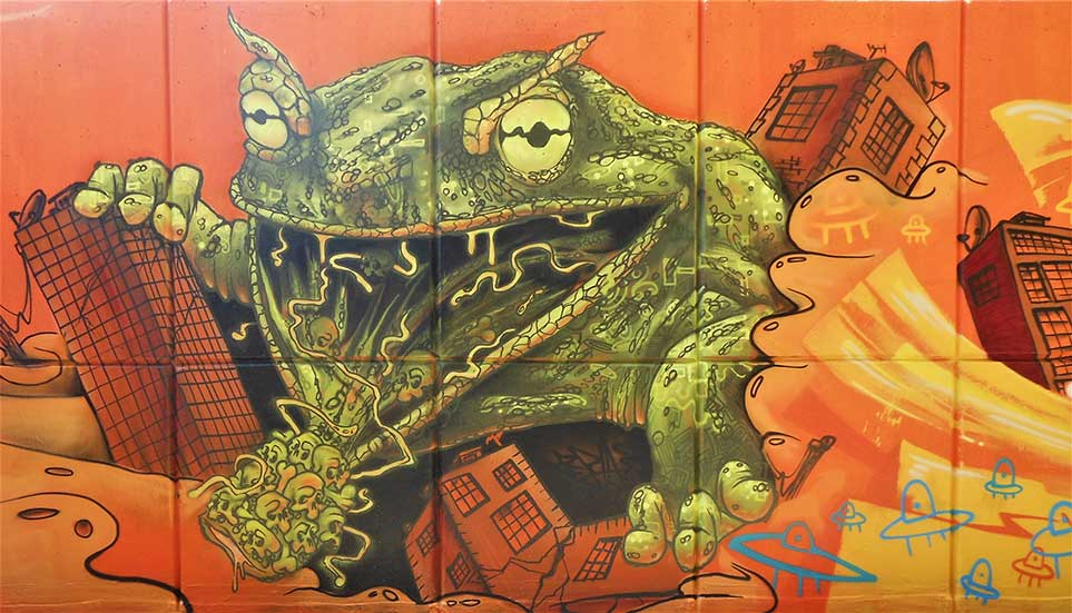 street art mural giant frog jumping through a city