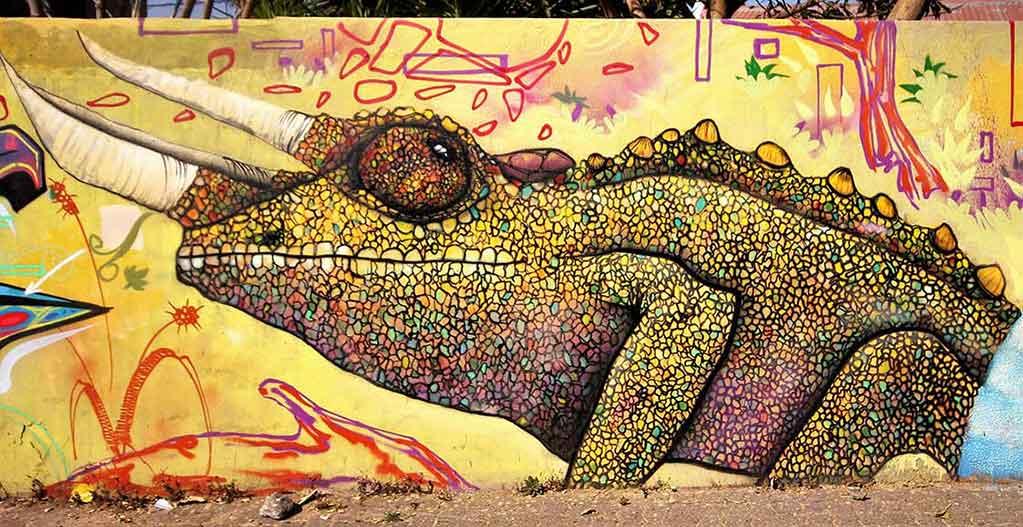 graffiti street art painting of a chameleon