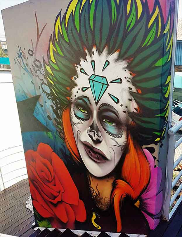 mural art female sugar skull and feathers with a rose