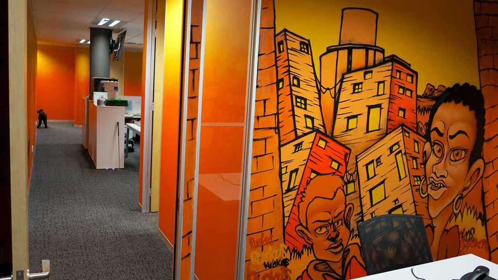 office murals in meeting room and in office space in background