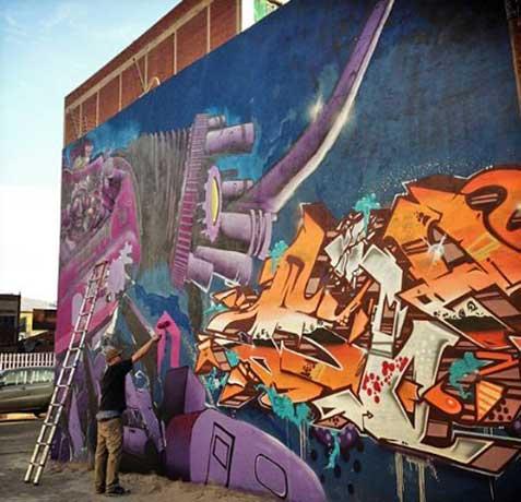 graffiti artist painting street art mural