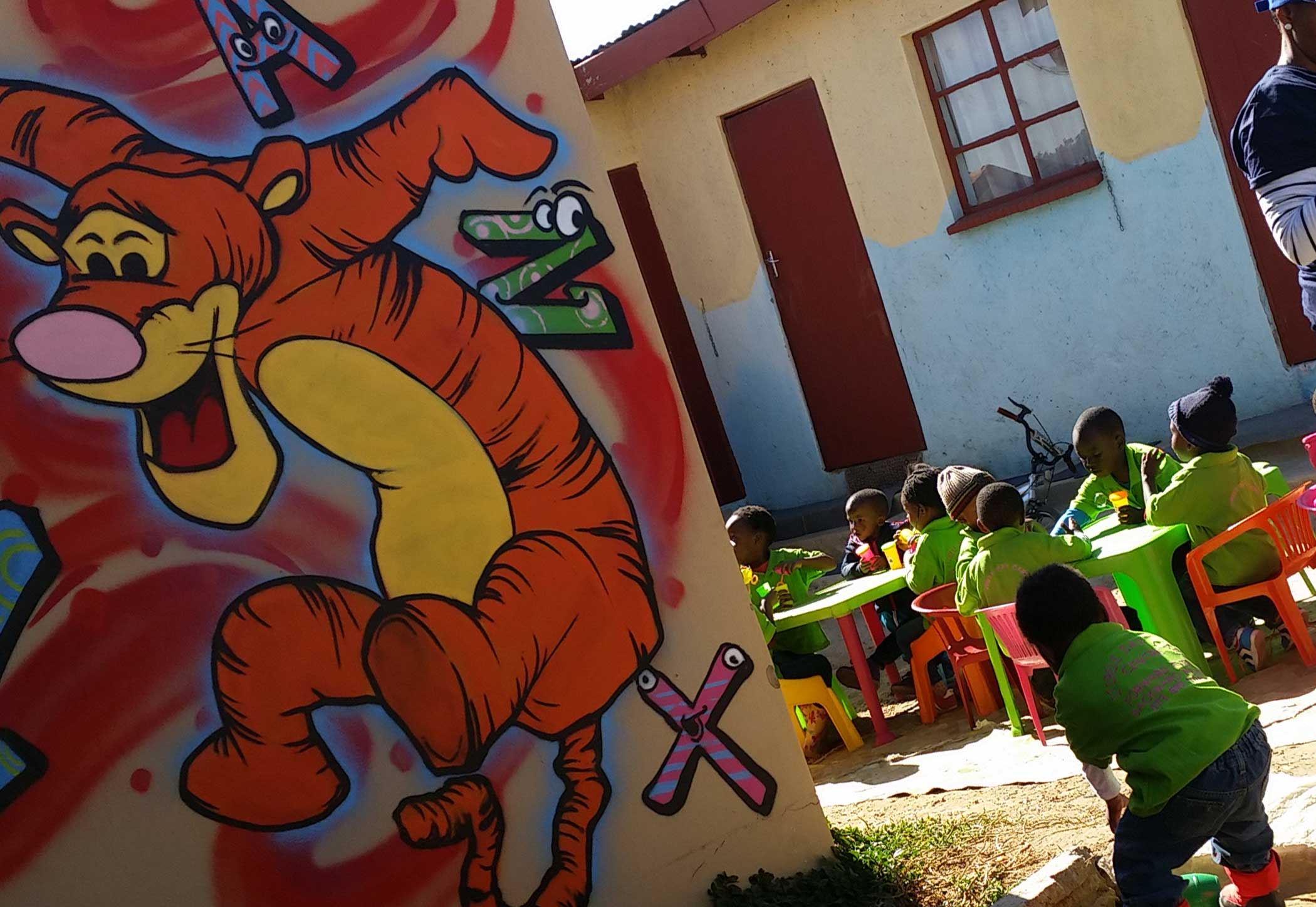 How to decorate a children's creche with wall murals.
