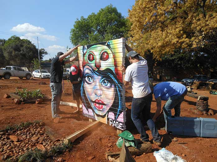 people installing art installation geurrilla gardening Page 33