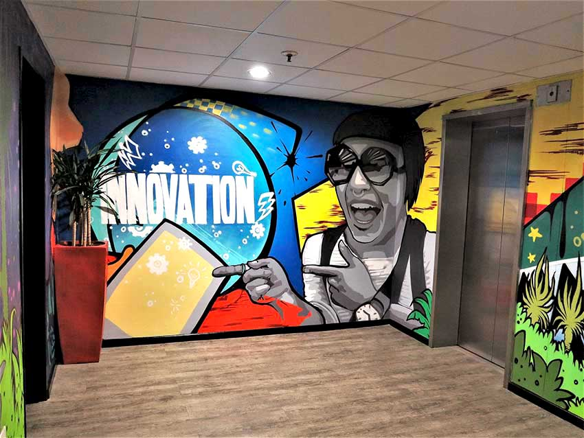 vibrant wall mural art in lift lobby, company value, innovation, written with icons and a vector female portrait on a colourful backgournd