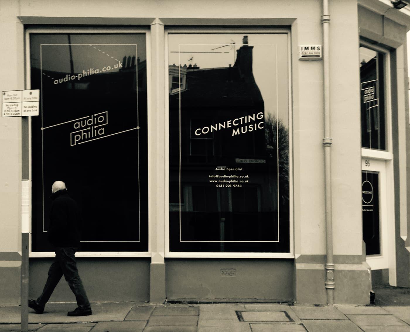 AudioPhilia Man walking past shop livery