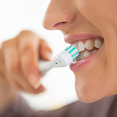 Photo of Woman Brushing Teeth