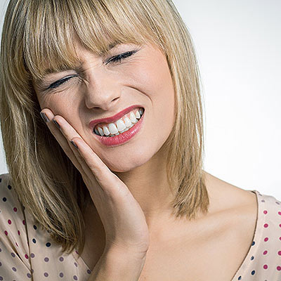 Photo of Woman appearing to be in mouth pain