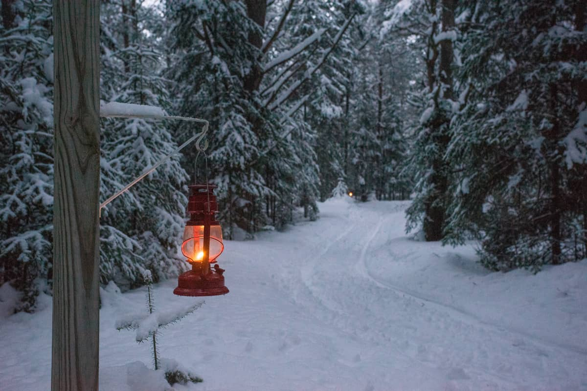 Kerosene lantern-lit trails at the Lake Clear Lodge & Retreat