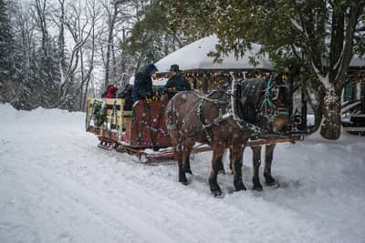 Local farm offering lantern-lit Sleigh Rides near Lake Placid, NY at the Lake Clear Lodge & Retreat
