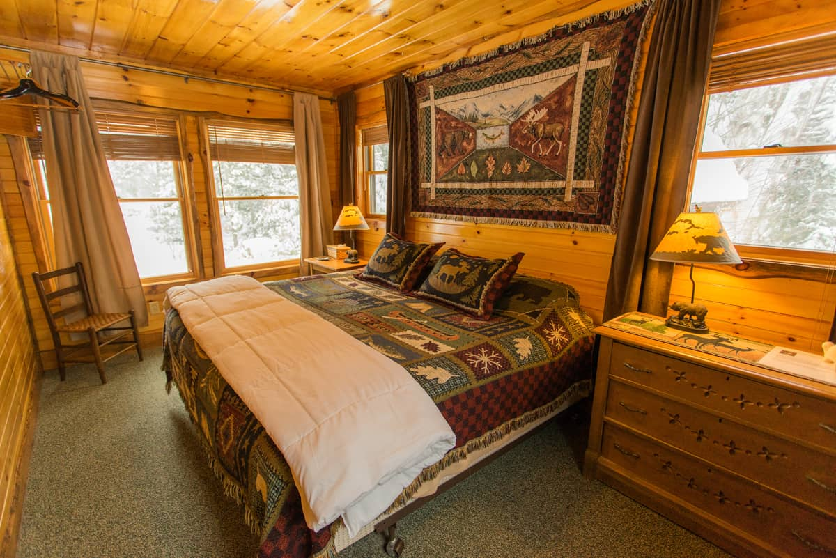 Adirondack Master Bedroom in Writers Cabin During the Winter