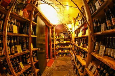 The Lake Clear Lodge's USA TODAY Featured beer cellar, hand-crafted with over 70 styles of beer on the shelves made out of wood milled from the property.