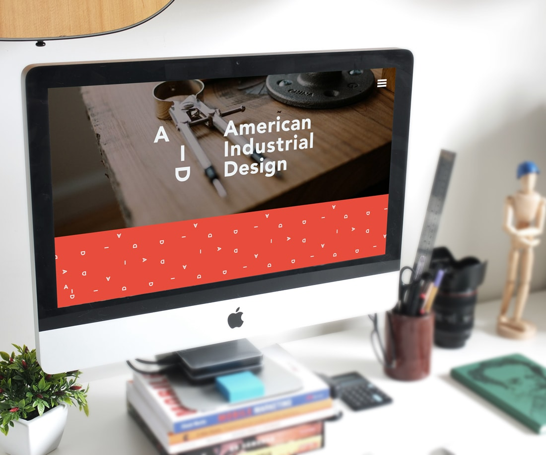 Artist's studio with American Industrial Design website on the screen
