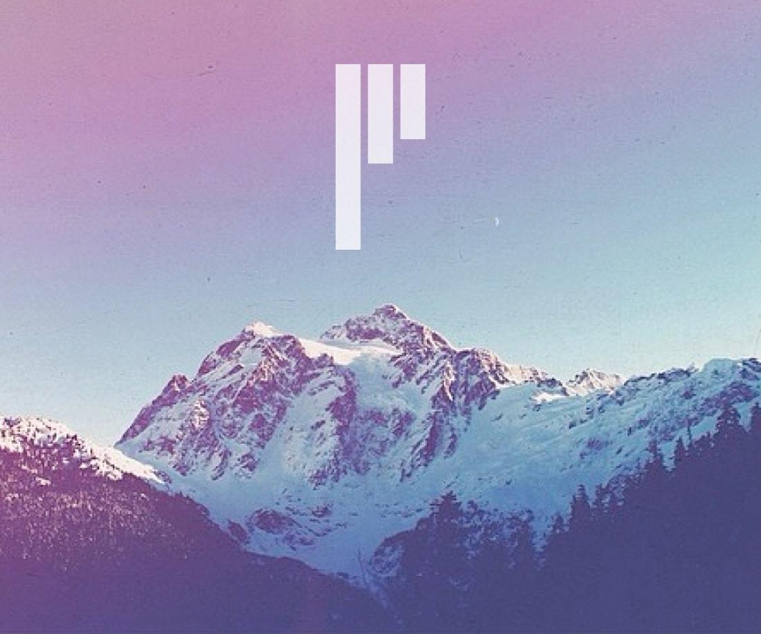 Pinnacle symbol placed on Pacific Northwest iconic mountain range photo. © LET'S PANDA