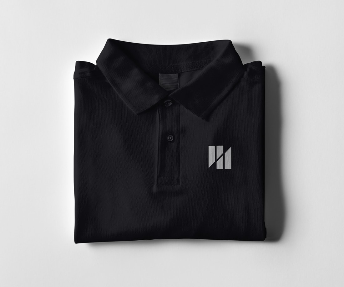 Black polo with a Project Detail Symbol
