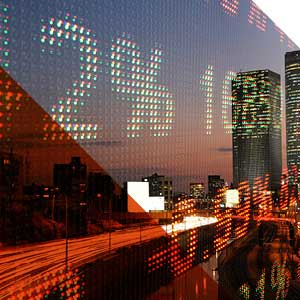 Large digital numbers over a city landscape. Stock exchange.