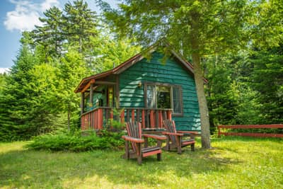 Guides Cabin in Summer with Adirondack Chairs