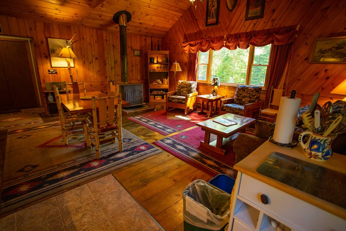 November Moon Chalet living area with wood burning fireplace and dining area