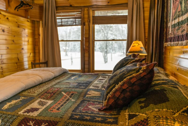 Writer's Cabin Bedroom with Snow Outside the Window