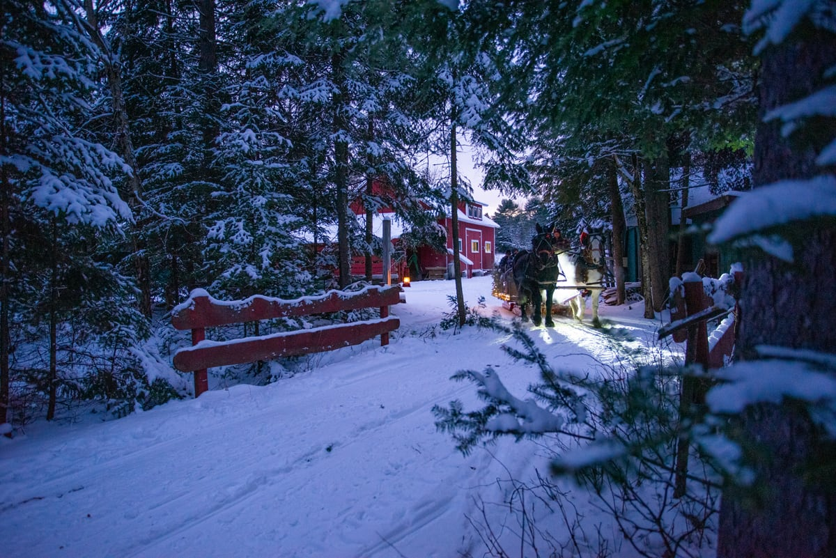 Horse-drawn Lantern-lit Sleigh Rides in the Adirondacks at the Lake Clear Lodge