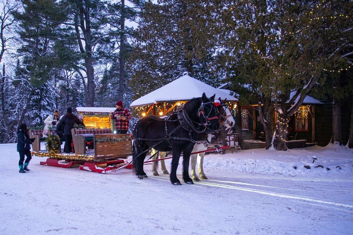 Horse-drawn Lantern-lit Sleigh Rides in the Adirondacks at the Lake Clear Lodge