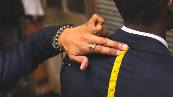 Tailor fitting man for suit