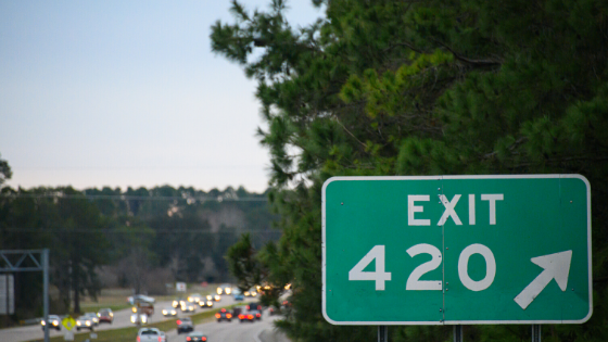 "highway with sign that reads ""exit 420"""