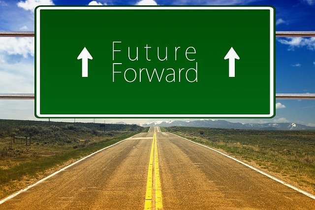 road with sign that says future forward with arrows
