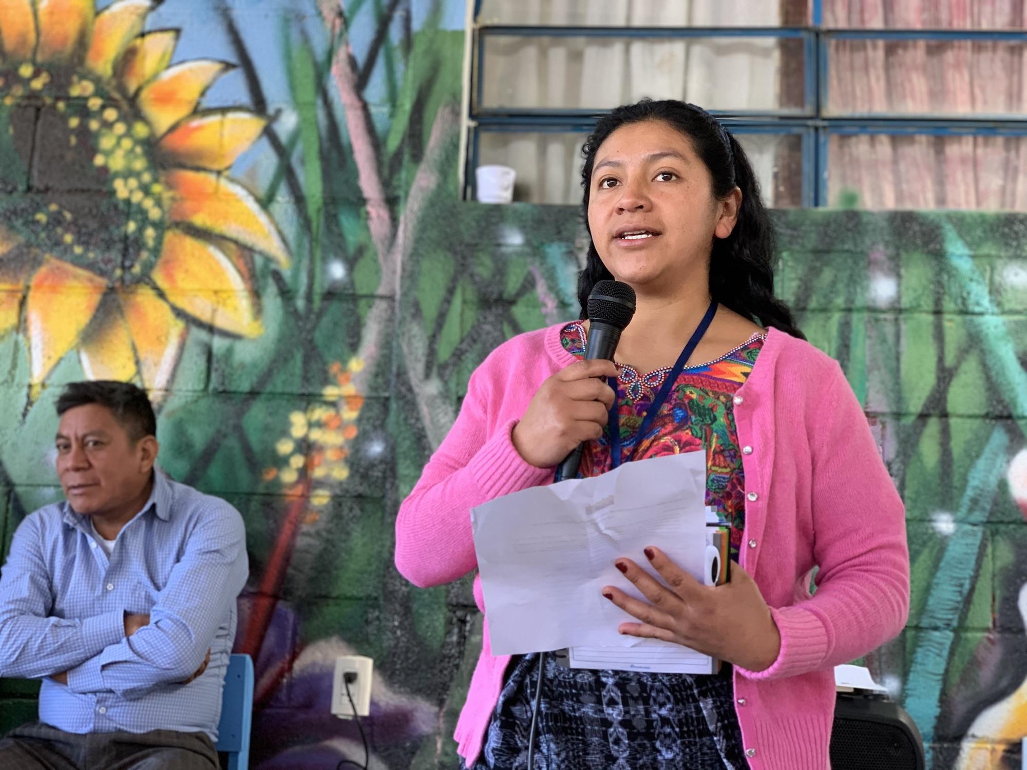 Indigenous woman Guatemala speaking into microphone