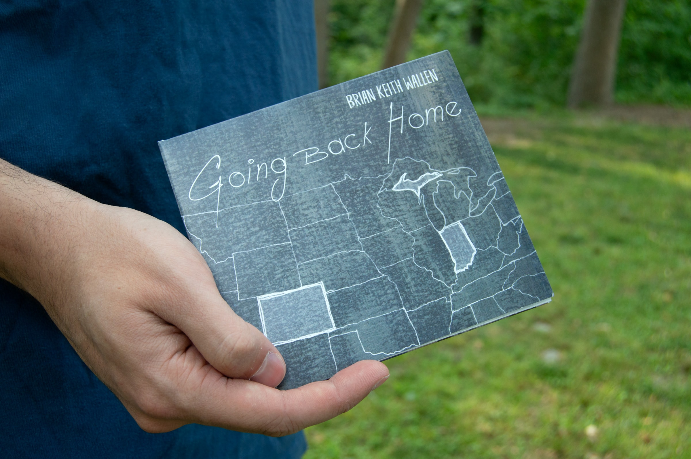 "The front cover of a CD case highlighting three U.S. states. The album title is ""Going back Home."""