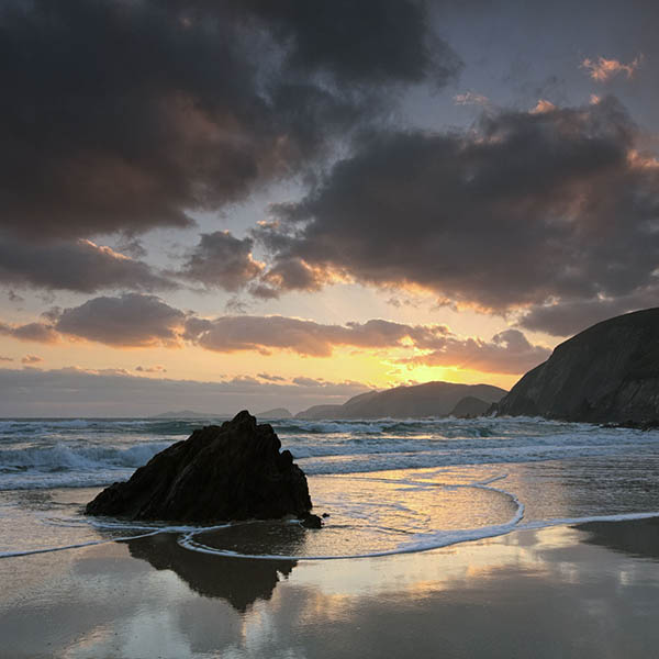 Sun setting over the Great Blasket from Coumeenoole beach in the Dingle Peninsula, Ireland, is one of the beautiful things to see in the area