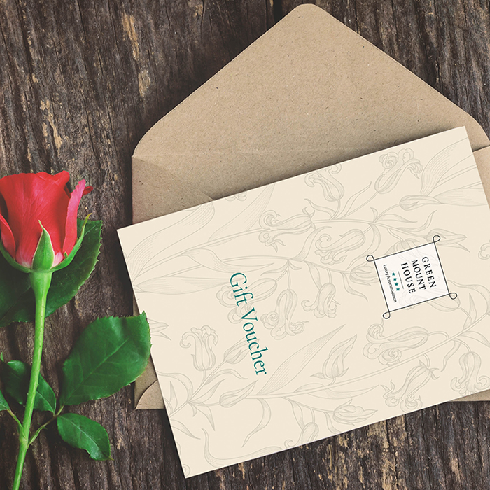 Greenmount House B&B luxury accommodation Gift Voucher pictured with a red rose