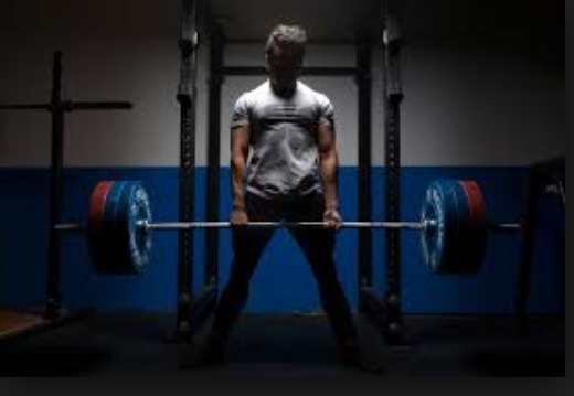 man holding bar with weights