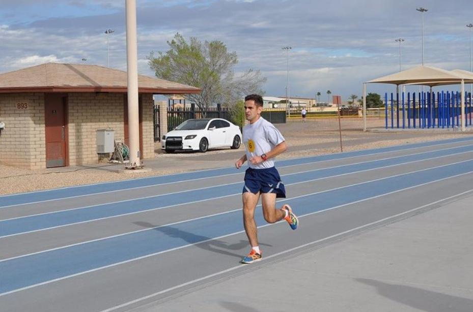man running on outdoor track