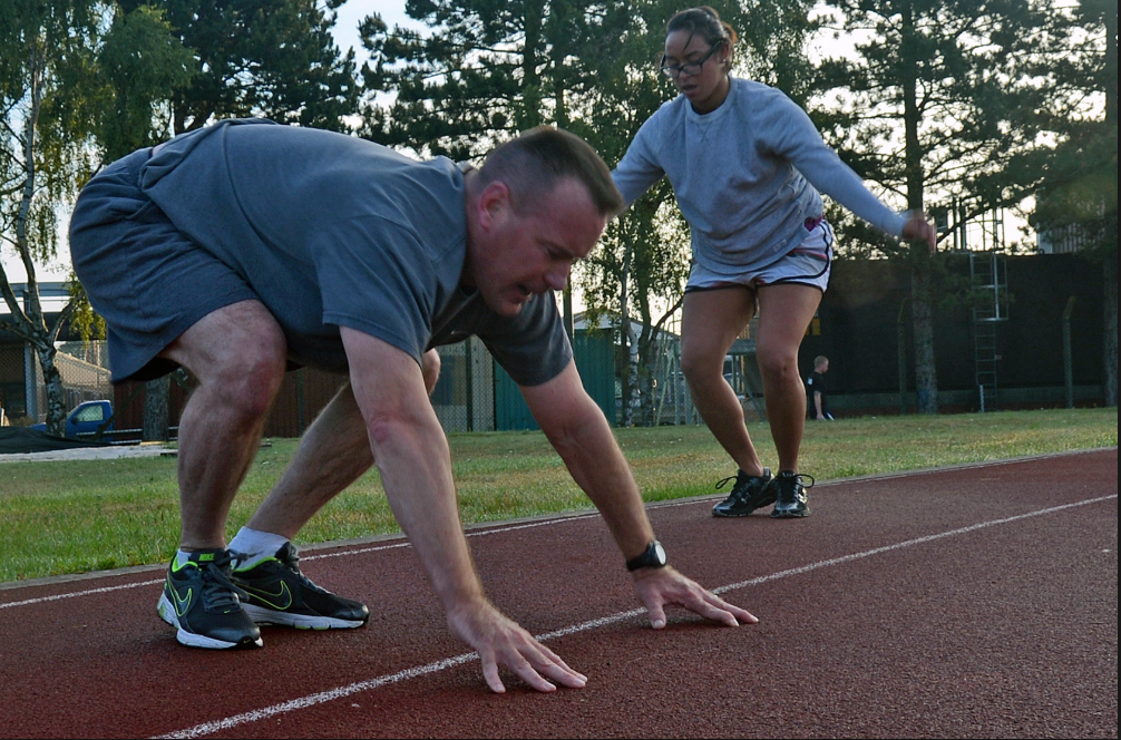 two athletes doing burpees