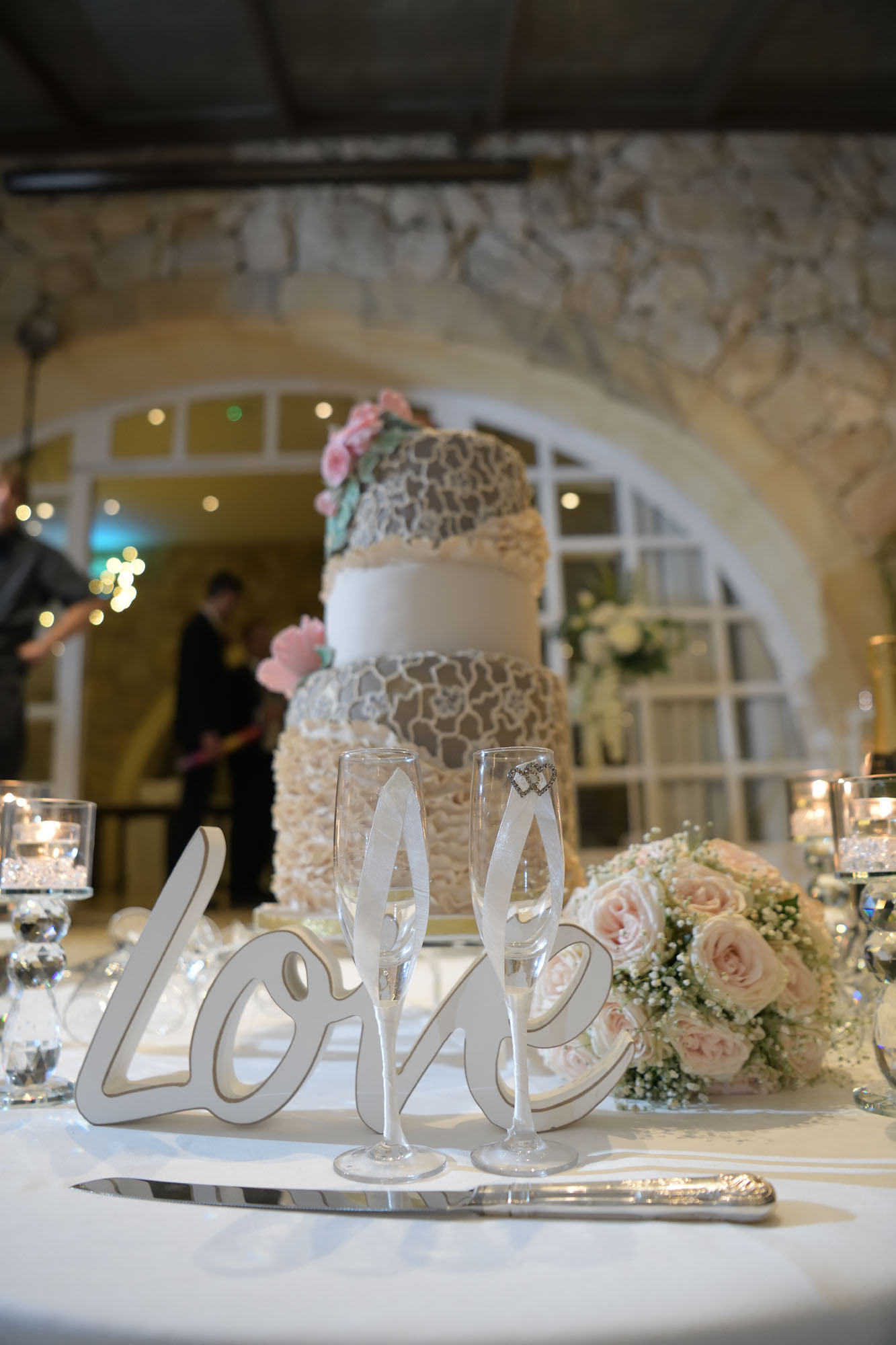 Love sign in front of Wedding Cake - photo Anaca Photography Gozo
