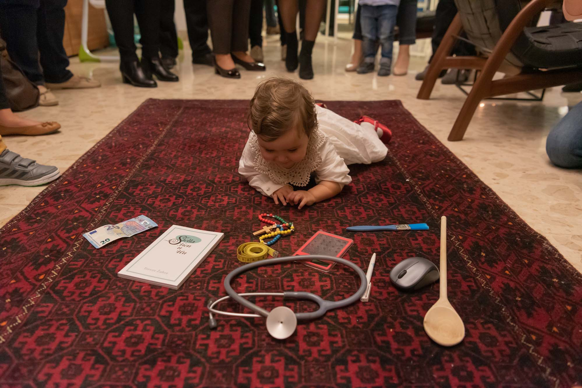 Infant doing the tradition of Quccija in Malta