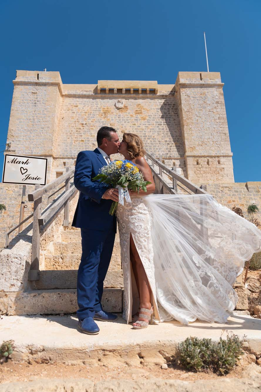 A photo from a pre-wedding in front of the Santa Marija Tower on Comino