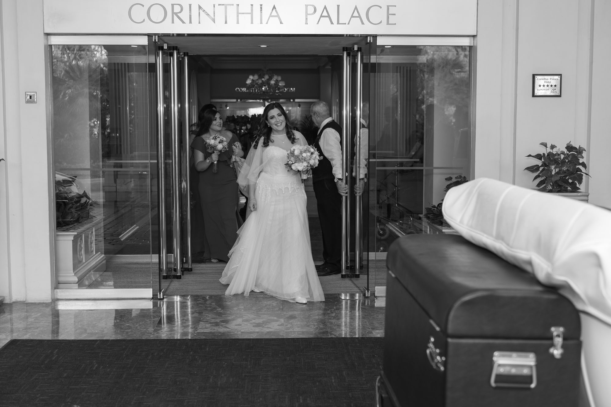 Bride happily leaving Corinthia Palace Hotel for Wedding.