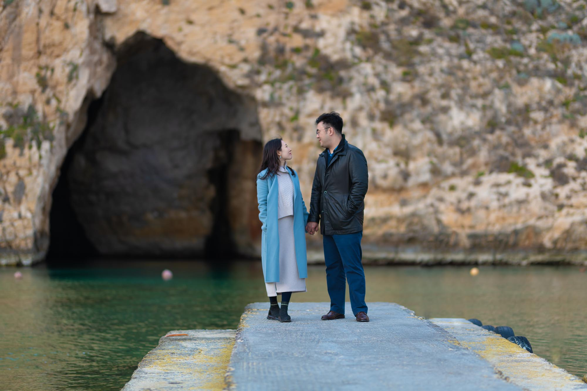Photo of a Korean Couple in the Dwejra Inland Sea in front of  the Blue Cave in San Lawrenz, Gozo