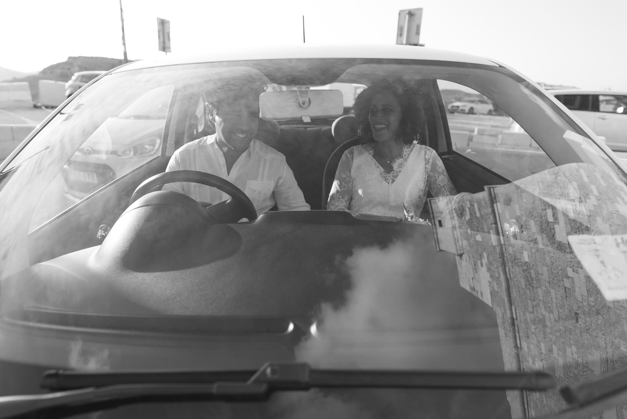 Newly Married Couple smiling in car in Gozo - photo by Anaca Photography