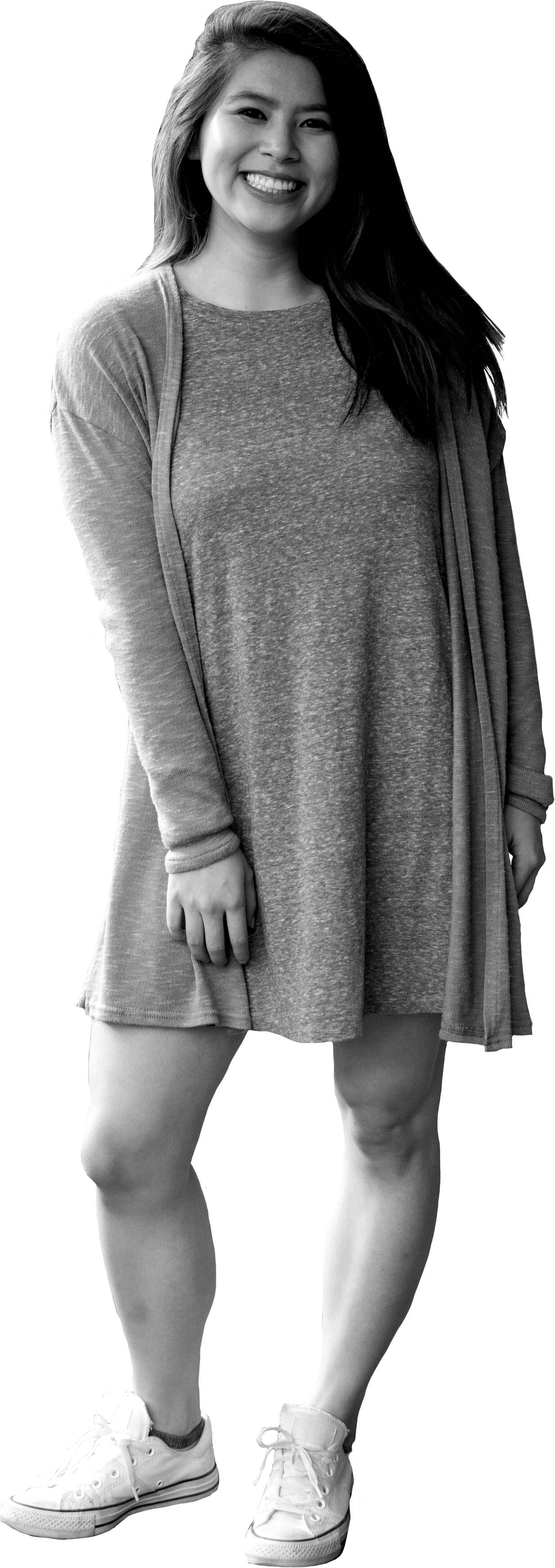 Image of Kimmie standing with her weight on her left hip, smiling at the camera. Kimmie is of Asian descent and has long, straight dark hair and a huge smile. She is wearing a swingy dress and a cardigan with white converse.