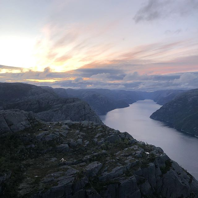 Image of the Kjerag Bolt. The rock formation stuck between mountains 700 meters about the fjord