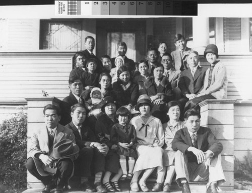 Group photo of Christian Layman Church, 1707 Ward Street, Berkeley. Father Takeji Manabe is in second row from top carrying young Emi Manabe. Chitose Manabe (mother) is holding Fumi Manabe (in light colored baby bunting). Sachi Takahashi is the girl in the middle front (dark dress).