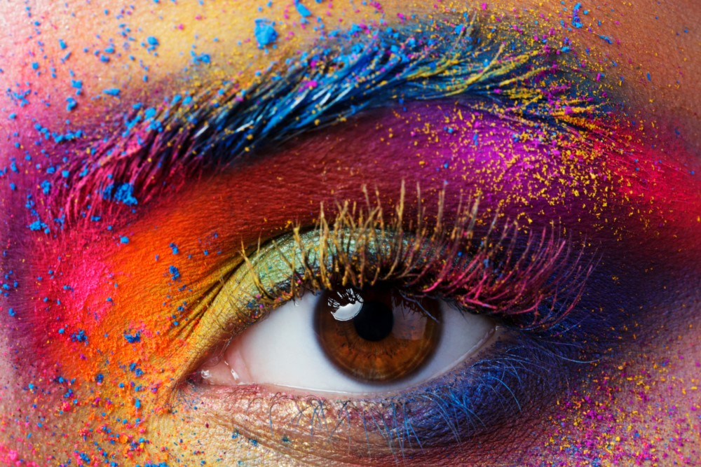 Colorful picture of eye covered in pigmented powder