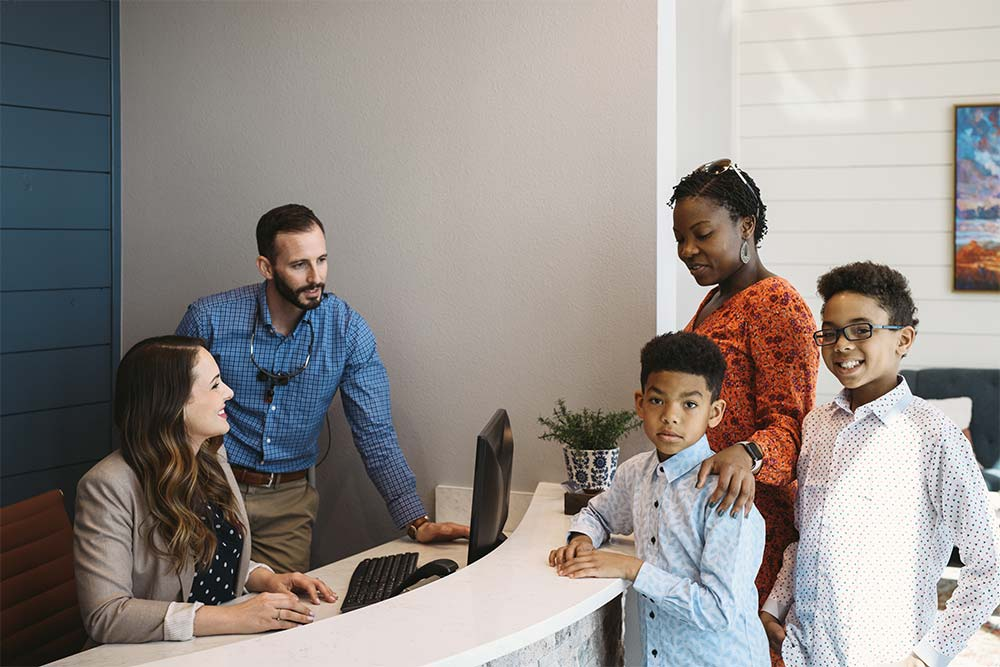 Photo of a family talking with Dr. McPhee and a staff member