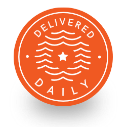 Circular orange badge calling out food being delivered fresh daily