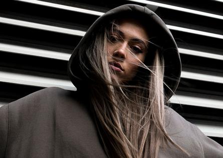 Streetwear woman wearing grey hoodie