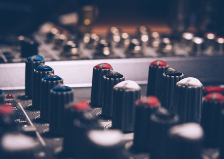 Audiofirm - close up photo of studio soundboard and knobs