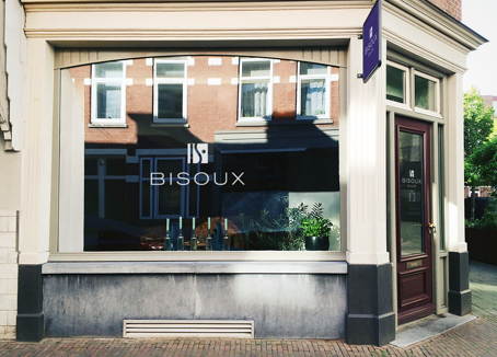 Exterior of a high end woman's salon with window graphics - bisoux
