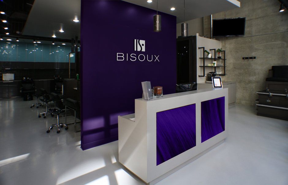 Interior of high end woman's salon with purple backdrop - bisoux